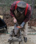 Tim forging a stake