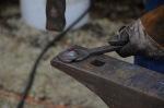 Forging the head using a nail heading tool