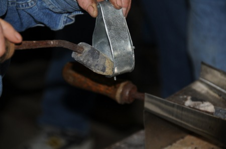 Soldering handle rivets
