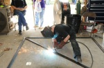 Wayne welding a door brace