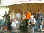Scout Leaders present plaque to Gulf Coast Blacksmith team