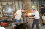 Scott and Phil sharpen a brushhog blade