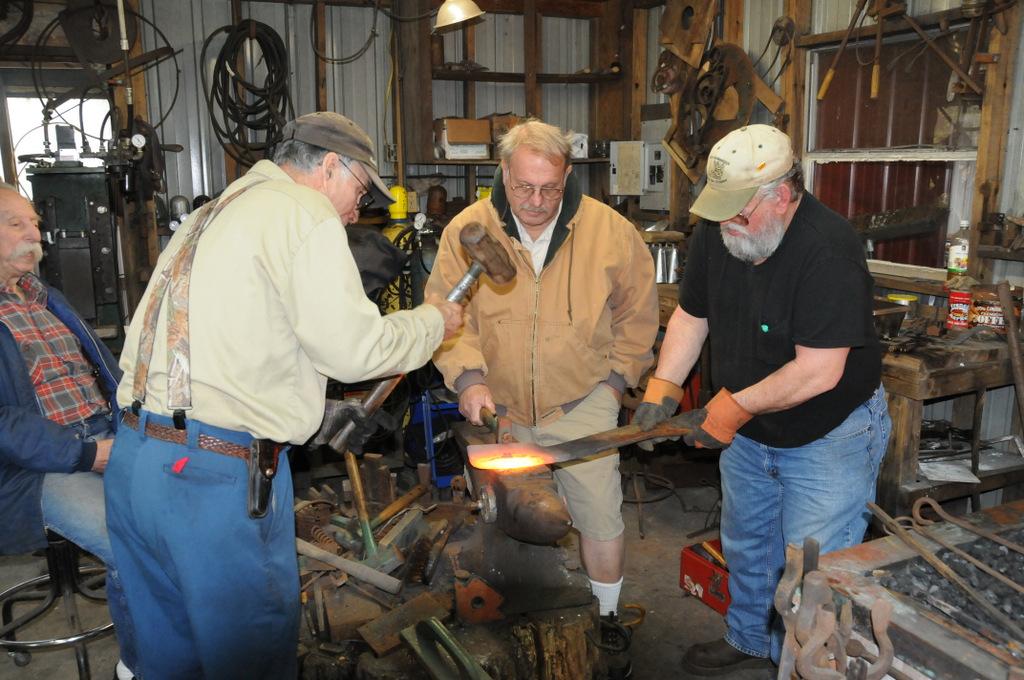 Buddy Directs A Bush Hog Blade Sharpening Session Gulf